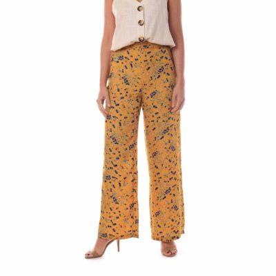 Pantalón de mujer fluido con estampado de flores y fondo mostaza
