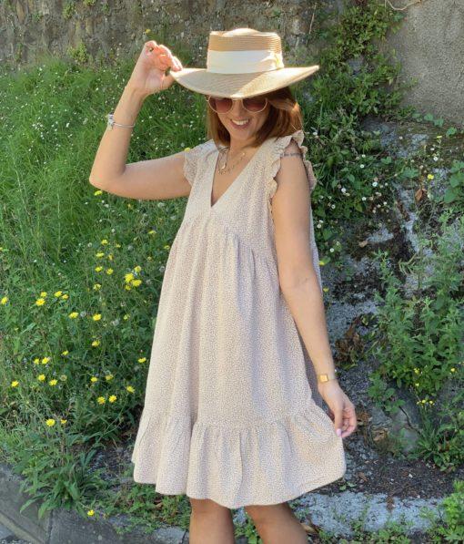Vestido corto color beige con estampado de flores